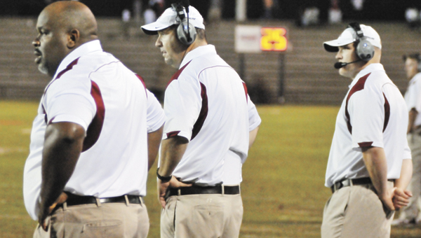 Andalusia coaches Marshall Locke, Brian Seymore and Jacob King react close to the finish of their team's loss Friday night. | Andrew Garner/Star-News