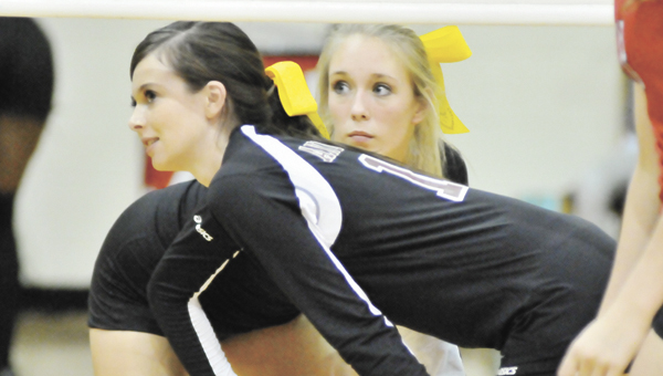Andalusia's Haley Harper and Shelby Meeks wait for a serve during an earlier match. | Andrew Garne/r/Star-News