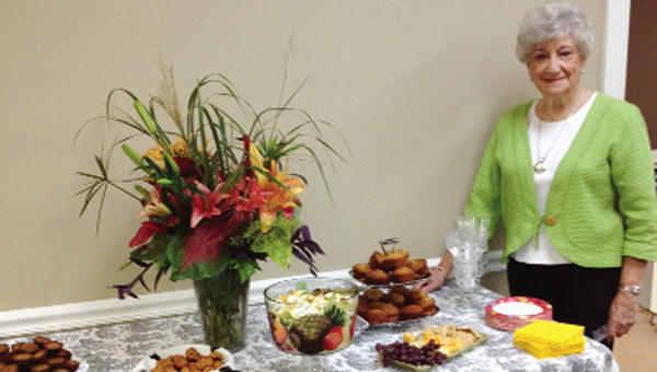 Jerri Stroud poses with her arrangement.