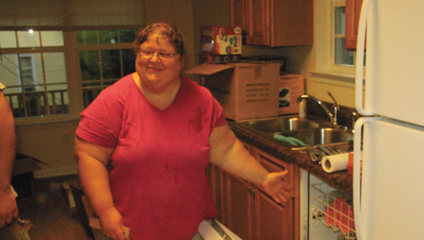 Tammy Sanford shows off her new kitchen in a home built by Habitat for Humanity.