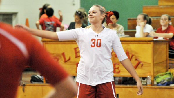 Pleasant Home's Allison O'Neal reacts after an ace Thursday night. | Andrew Garner/Star-News