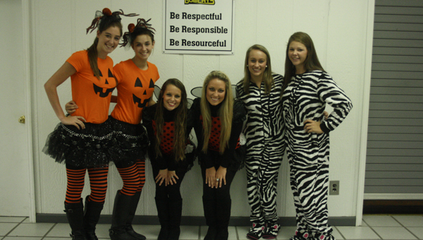 """Opp High School seniors, from left, Caiden Harrell, Laiken Free, Bethany Elmore, Whitney Wilson, Olivia Jones and Alex Ann Ballard took part in """"twin day"""" on Tuesday as part of this year's homecoming week."""