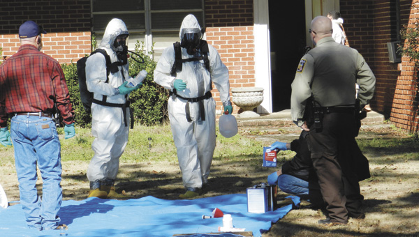 Agents had to 'suit up' to protect themselves against the toxic fumes found inside the home.