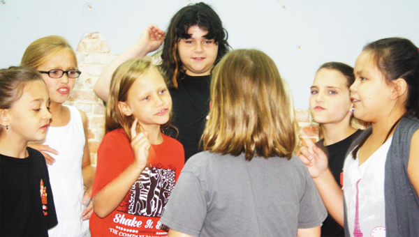 "Pictured practicing songs for the musical, ""Annie,"" are, from left, Rylee Reynolds, Ellery Roquemore, Liz Ann Jackson, Sarah McCarthy, Robin Correro, Teagan Northy and Brennan Mack."