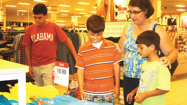 Pictured shopping for back to school clothes at JCPenney in Andalusia are Pleasant Home School students, from left, Gerard Boles, John Isaac Boles, mother Tina Boles and Noah Boles.