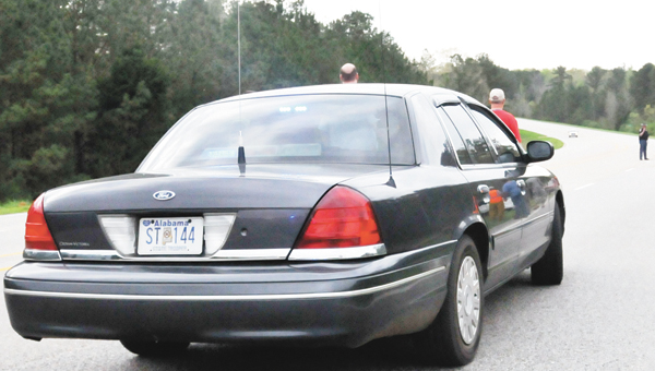 Shown is a state trooper vehicle at a wreck in Covington County.   Andrew Garnerr/Star-News