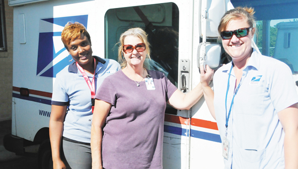 Andalusia Post Office Letter Carriers Lakeesha Dexter, Glenice Baxley and Tonya Mayberry pose next to a mail truck Friday afternoon. |                Andrew Garner/Star-News