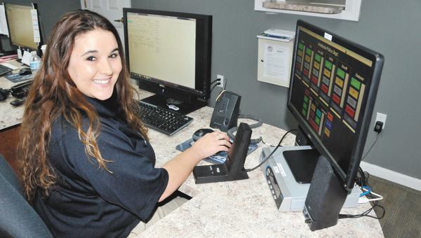 Tabitha Daniel is shown wtith the new digital system. | Andrew Garner/Star-News