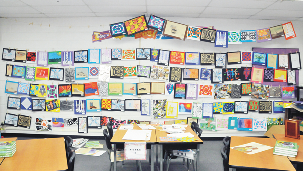 Shown is the wall of artwork in Kay Bellino's Opp Middle School classroom. An artshow will be held Tuesday at 6 p.m. in the multipurpose room at OMS. | Andrew Garner/Star-News