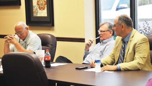 County Commission Chairman Bill Godwin, Andalusia Mayor Earl Johnson and Opp Mayor John Bartholomew listen during Friday's special-called Airport Authority meeting to discuss lease proposals for Vector Aerospace. | Andrew Garner/Star-News