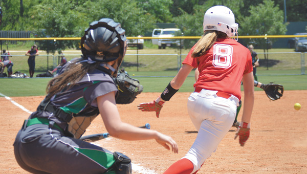 Pleasant Home's Jade Self singles up the middle. | Josh Dutton/Star-News