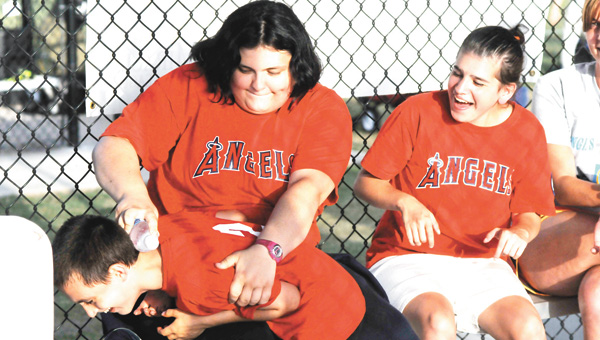 The Miracle League of Covington County held its final game of the season Tuesday night. Players from the Angels and Braves were all excited to finish the season on a high note. Before the game, Lizzy Heitzman, Elijah Boyington and Sarah Castillo were having a little fun before taking the field. | Andrew Garner/Star-News
