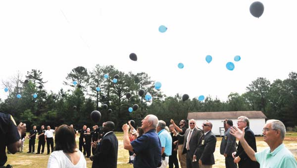 Eventgoers released balloons in memory of the officers killed in the line of duty in Covington County throughout the years.  | Andrew Garner/Star-News