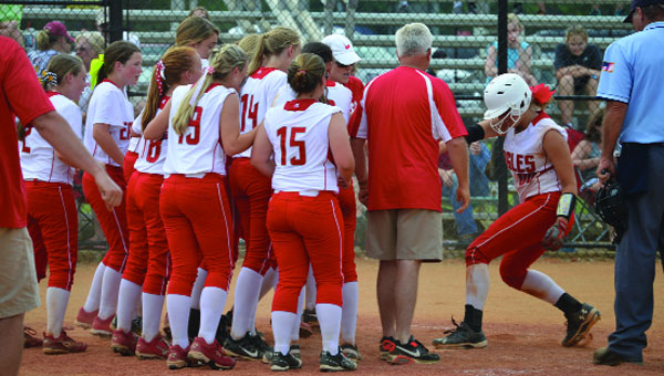 Cassidy Godwin crosses home after hitting a walk-off home run against South Lamar.