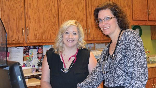 Christyl Hines (left) poses for a picture with Gabrielle Baldwin at Covington Pediatrics. | Michele Gerlach/Star-News