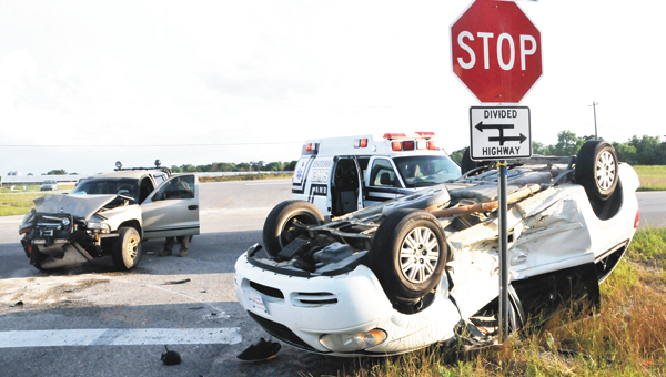 A gold Dodge Dakota 4x4 and a white Chrysler van collided at the intersection of Hwy. 84 and Airport Road Tuesday evening. | Andrew Garner/Star-News