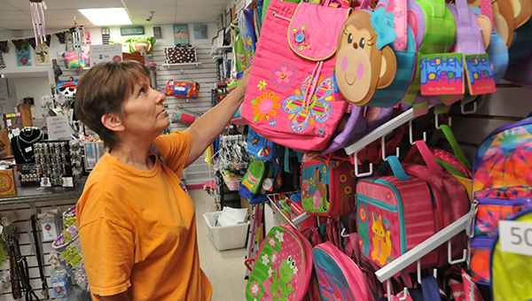 Local stores were full of shoppers taking advantage of the tax free weekend, which continues until tomorrow. Above: Kay Jones looks at backpacks at Pink Peppers in Andalusia.   Andrew Garner/Star-News