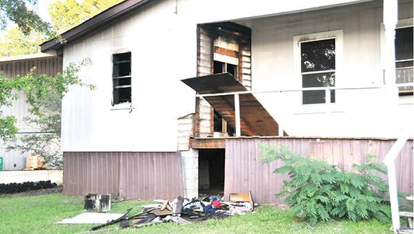 This Berry Avenue home caught on fire Tuesday evening. | Andrew Garner/Star-News