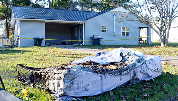 Shown is a burned mattress in front of the home at 304 East Pass Road.