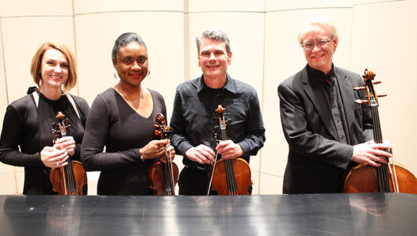 Shown are the members of the James C. Carter String Quartet.