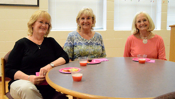 Holly Krudop, Amy Spurlin and Babs Mikel attended Thursday's tea at Andalusia High School's library.  Josh Dutton/Star-News