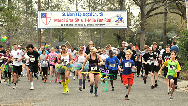 Runners take off in a previous St. Mary's 5K for its rice and beans program.