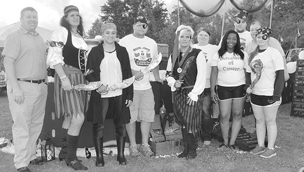 Defenders of Cancer Team members, from Walmart, include Carla Reycraft, Rachel James, Aaron Gay, April Kyser, Jessica Centner, Shana Howell, Melissa Howell, Will Lydick, Steven Howell, Anjelica Bonham.