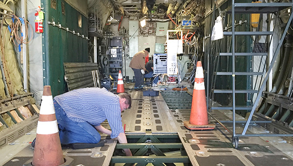 A quality inspector for NASA reviews modifications made to the agency's C130.