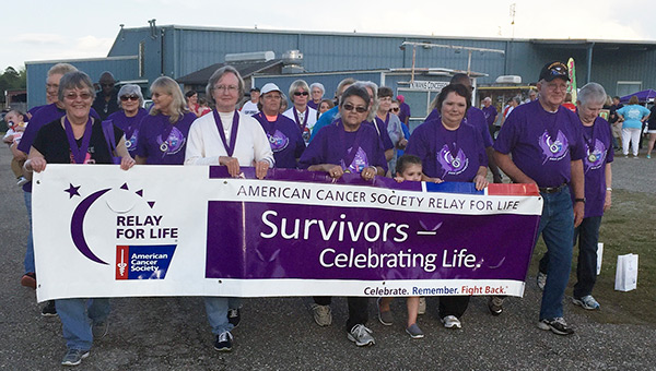 Leading the survivors' lap were (from left) Gladys Martin, Myra Mullins, Teresa Carter, Nattaleigh Zigler, Debbie Howard and Webster Martin.