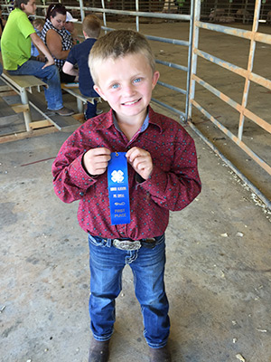 Levi Macks won first place in two competitions at the 4-H Pig Squeal.  Photographer/Star-News
