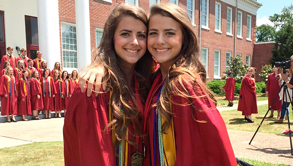 Twin sisters Hannah McCalman, left, and Elizabeth McCalman, right, are the val and sal at AHS.