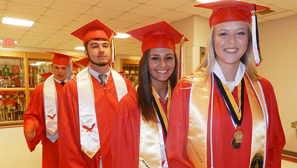 Cassidy,-Anna-and-Chase-lead-grads