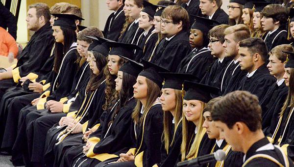 Grads sitting