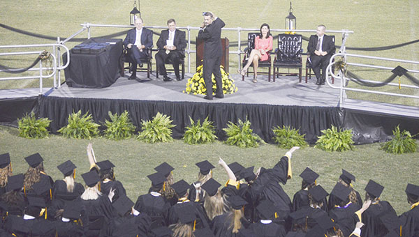 Opp High School principal Ron Snell takes a selfie from the podium during commencement on Thursday.