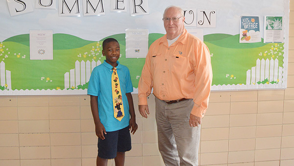 "Cameron Johnson and ""Uncle Bob"" (Bob Brooks) are looking forward to a summer full of fun at the A.P.P.L.E. program. Johnson said he dresses for success because he is going to be the president one day."