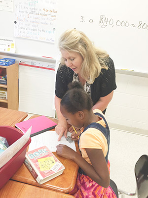 Mrs. Diane Calhoun talks with a student in her class on Wednesday.  Courtesy photo