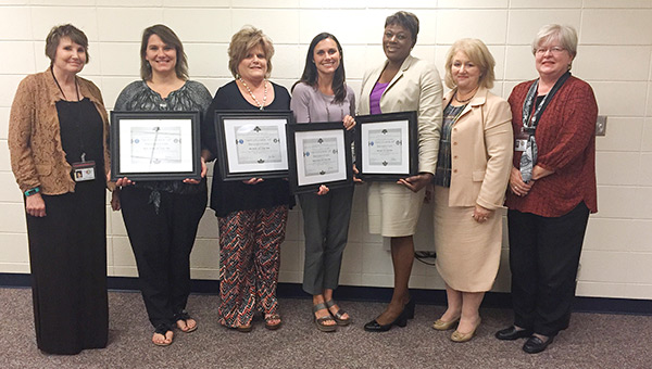 Shown from left are Susan Williamson, ALSDE; Becky Garner, 7th grade reading teacher; Cindy Odom, collaborative teacher; Amy Bryan, 7th grade math; AJHS assistant principal Victoria Anderson; district administrator Sonja Hines; and Rebecca Hardaman, ALSDE instructional coach.