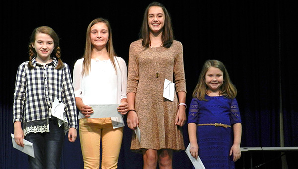 Winners in the K-6 division of the 2016 Covington County Fair chosen Tuesday night are (from left) Ivy Rogers, who yodeled her way to first place; Kelsey Kelley, tie for third; Marion Bradley, second place; and Hannah Griffin, tie for third.