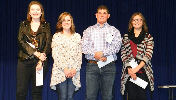 Winners in the 7-12 division of the 2016 Covington County Fair chosen Tuesday night are (from left) Maggie Anderson, tie for third place; Callie Dauphin, tie for third place; Daniel Mock, second place; and Katelyn Griggs, first place.